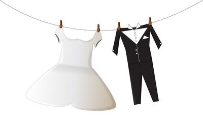 vestiti del matrimonio da sposa e da sposo appesi