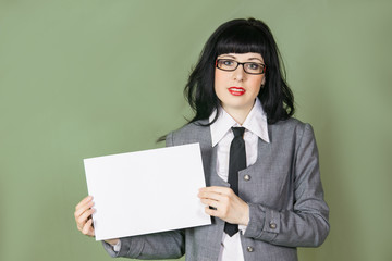 young woman in office dress with paper sheet on color background