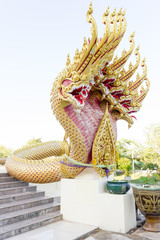 red Naga statue in temple entrance