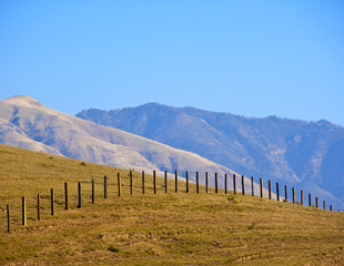 Wire Fence Extending over Hill