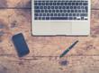 Obraz,Plakat - Laptop smart hone and pen on wooden table