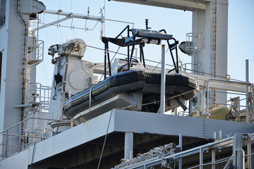 Inflatable amphibious boat on naval ship.