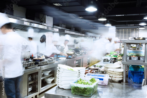modern kitchen and busy chefs - 82173540
