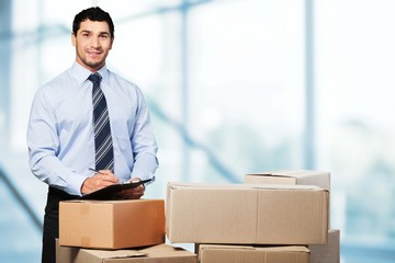 Business. Manager In Warehouse Checking Boxes