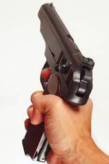 Hand with a army semi-automatic handgun close up