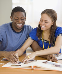 African couple making photo album