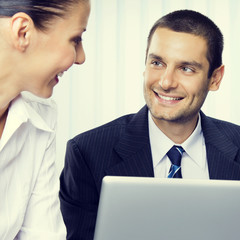 Cheerful smiling businesspeople working together
