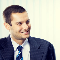 Smiling young businessman at office