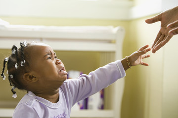 African girl crying and reaching upward