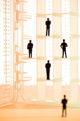 Illustration of business people on shelves
