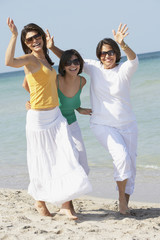 Mother and sisters playing on beach