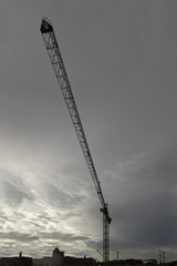 A tower crane in New Orleans, Louisiana against a gray stormy sky