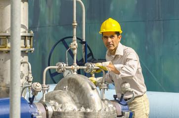 Hispanic worker checking valves