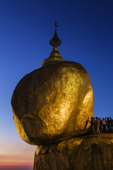 People standing at golden rock