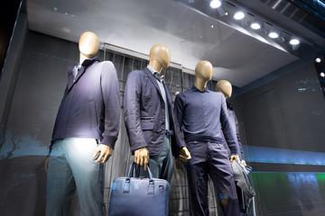 fashion store mannequins in window