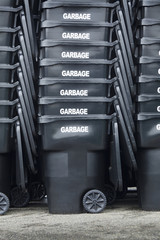 Stacked garbage cans