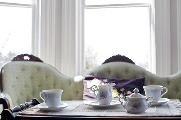 A sofa in a living room, and a tea tray.