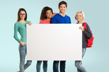 Youth. Group of young friends holding a blank board, isolated on