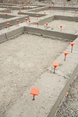 Orange Caps in Cement Foundation