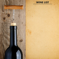 Bottle of wine with corkscrew and wine list