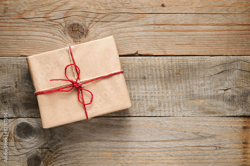 Gift box top view on wooden background - 82187594