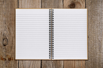 Notepad on old wooden background
