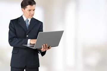 Entrepreneur. Social media concept, business man with laptop in