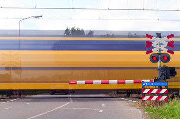 train with motion at railway crossing