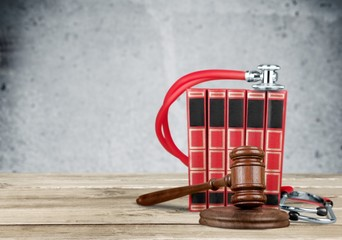 Law. Medicine law concept gavel and stethoscope on books