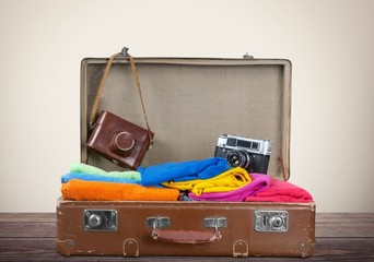 Clothing. Traveler luggage with hand drawn clothes and icons on