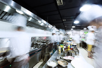 modern kitchen and busy chefs
