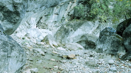 Dry bed of a mountain river water has gone under the ground