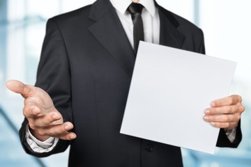 Employment. A businessman offering a handshake and holding a