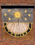 Detail of old sundial on church in old town in Gdansk, Poland.
