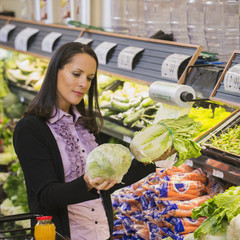 Hispanic woman shopping for produce in grocery store