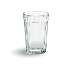 one transparent empty faceted glass on a white background