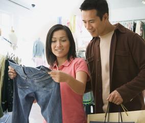 Asian couple clothing shopping