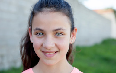 Portrait of a beautiful preteen girl with blue eyes