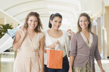 Friends in mall with shopping bags