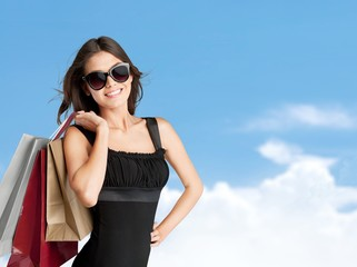 Consumerism. Shopping and tourism concept - woman with shopping