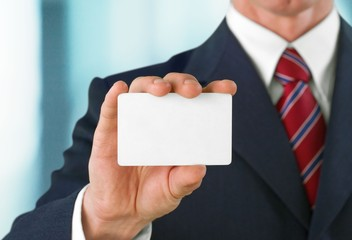 Business. Blank business card in a hand