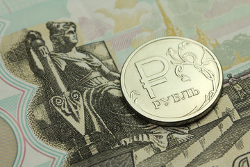 coin in one Russian ruble banknote fifty rubles background