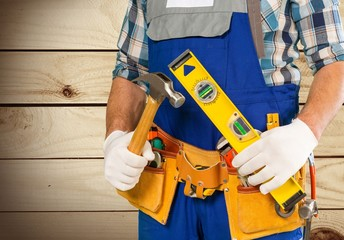 Handyman. Handyman with a tool belt. Isolated on white