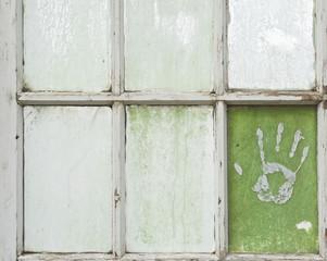 Hand Print on a Greenhouse Windowpane