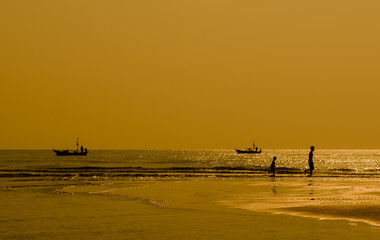 Silhouette of fisherman coming back home. hua hin, Thailand.