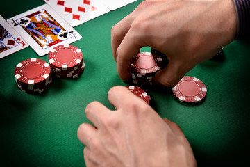 dealer collects red poker chips