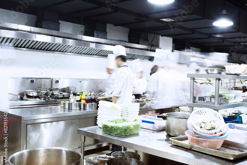 modern kitchen and busy chefs - 82193542