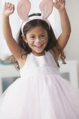 Hispanic girl wearing bunny ears and whiskers