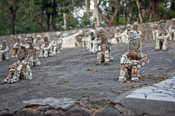 Small Figurines in Rock Garden