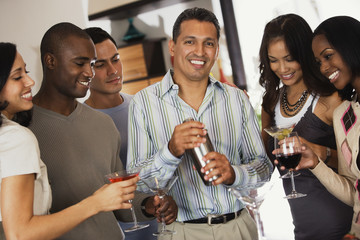 Multi-ethnic friends at party